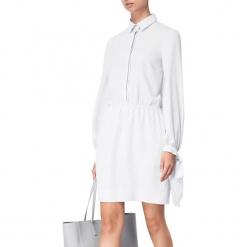 Sukienka w kolorze białym. Białe sukienki mini marki BOHOBOCO, z klasycznym kołnierzykiem. W wyprzedaży za 799,95 zł.