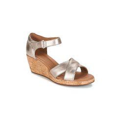Sandały Clarks  UN PLAZA CROSS. Żółte sandały damskie marki Kazar, ze skóry, na wysokim obcasie, na obcasie. Za 335,30 zł.