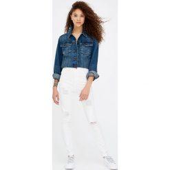 Jeansy rurki z przetarciami. Szare jeansy damskie marki Pull & Bear, okrągłe. Za 59,90 zł.
