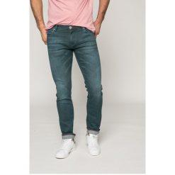 Tommy Hilfiger - Jeansy BLEECKER. Niebieskie jeansy męskie relaxed fit marki House, z jeansu. W wyprzedaży za 349,90 zł.