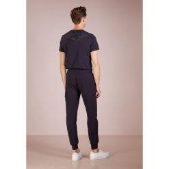 C.P. Company Spodnie treningowe total eclipse. Czarne spodnie dresowe męskie C.P. Company, z bawełny. Za 589,00 zł.