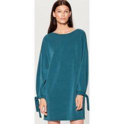Dzianinowa sukienka oversize - Turkusowy. Niebieskie sukienki dzianinowe marki Mohito, l, oversize. W wyprzedaży za 79,99 zł.