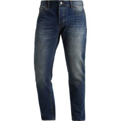 Dickies NORTH CAROLINA Jeansy Zwężane mid blue. Szare jeansy męskie marki Dickies, na zimę, z dzianiny. W wyprzedaży za 213,85 zł.