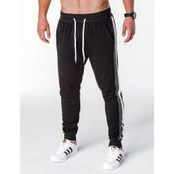 SPODNIE MĘSKIE DRESOWE P715 - CZARNE. Czarne spodnie dresowe męskie Ombre Clothing, z bawełny. Za 49,00 zł.