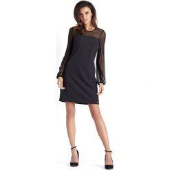 Czarna Wizytowa Sukienka z Tiulowym Rękawem. Czarne sukienki balowe marki Molly.pl, do pracy, l, z tiulu, z okrągłym kołnierzem, z krótkim rękawem, mini, trapezowe. Za 189,90 zł.