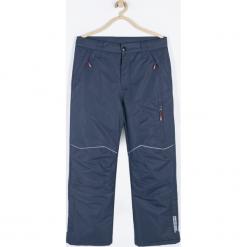 Spodnie. Niebieskie spodnie chłopięce Winter Time, z nadrukiem, z gumy. Za 159,90 zł.