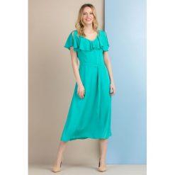 Sukienki: Kobieca sukienka z falbanką