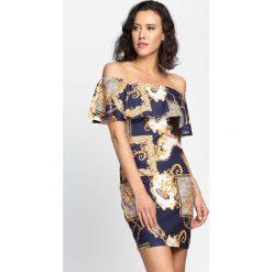 Granatowa Sukienka Eye Of The Storm. Szare sukienki hiszpanki marki Molly.pl, l, w koronkowe wzory, z koronki, eleganckie, z dekoltem typu hiszpanka, z krótkim rękawem, midi, dopasowane. Za 29,99 zł.