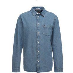 Tommy Jeans CLEAN Koszula blue. Niebieskie koszule męskie jeansowe marki Tommy Jeans, m. Za 399,00 zł.
