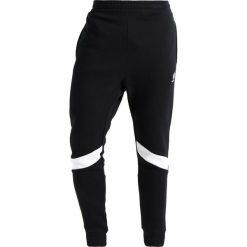 Spodnie dresowe męskie: Reebok Classic Spodnie treningowe black