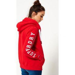 Superdry Bluza rozpinana red/white. Czerwone bluzy rozpinane damskie marki Superdry, xs, z bawełny. Za 379,00 zł.