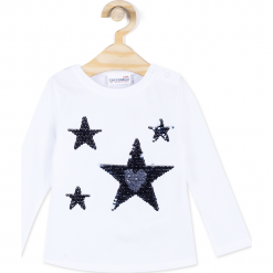 Koszulka. Białe bluzki dziewczęce bawełniane marki MAGIC IS ALL AROUND, z aplikacjami, z długim rękawem. Za 29,90 zł.