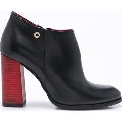Carinii - Botki. Czarne buty zimowe damskie marki Carinii, z materiału, z okrągłym noskiem, na obcasie. W wyprzedaży za 199,90 zł.