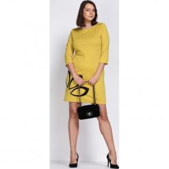 Ciemnożółta Sukienka Echo Arms. Żółte sukienki marki Born2be. Za 24,99 zł.