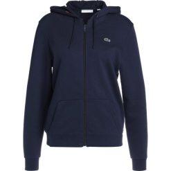Lacoste Sport WOMEN TENNIS Bluza rozpinana navy blue/apricot. Niebieskie bluzy damskie Lacoste Sport, z bawełny. Za 409,00 zł.