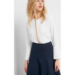 Bluzka z diamencikami. Brązowe bluzki asymetryczne Orsay, s, z poliesteru, z okrągłym kołnierzem. Za 89,99 zł.