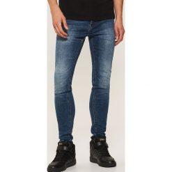 Jeansy skinny - Niebieski. Niebieskie jeansy męskie skinny marki House, z jeansu. Za 99,99 zł.