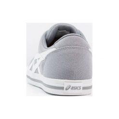 Asics Tiger AARON Tenisówki i Trampki stone grey/white. Szare tenisówki damskie Asics Tiger, z materiału. W wyprzedaży za 242,10 zł.