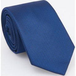 Niebieski krawat z żakardowym wzorem - Granatowy. Niebieskie krawaty męskie Reserved, z żakardem. Za 49,99 zł.