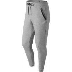 New Balance MP83506AG. Szare joggery męskie marki New Balance, z bawełny. Za 199,99 zł.