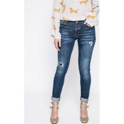 Guess Jeans - Jeansy Curve X. Niebieskie jeansy damskie rurki marki Guess Jeans. W wyprzedaży za 399,90 zł.