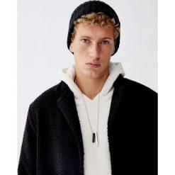 Sweter z kapturem z dzianiny bouclé. Czarne swetry klasyczne męskie marki Reserved, m, z kapturem. Za 89,90 zł.