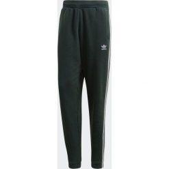 Spodnie męskie: Adidas Spodnie dresowe męskie 3-Stripes zielone r. S (CX1898)