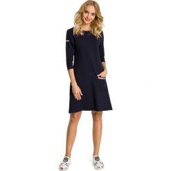 DELICE Sukienka trapezowa z kieszenią - granatowa. Niebieskie sukienki balowe Moe, na co dzień, z dzianiny, trapezowe. Za 129,99 zł.
