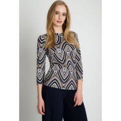 Bluzki asymetryczne: Elegancka bluzka we wzory BIALCON