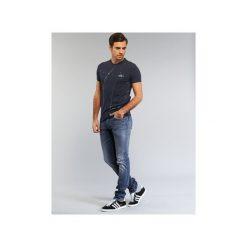 Jeansy slim fit Armani jeans  NAKAJOL. Czarne jeansy męskie relaxed fit marki Armani Jeans, z jeansu. Za 671,30 zł.