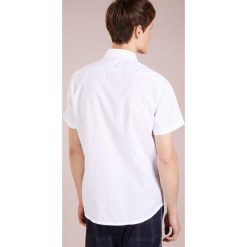 BOSS CASUAL RASH REGULAR FIT Koszula biznesowa white. Białe koszule męskie BOSS Casual, m, z bawełny. Za 379,00 zł.