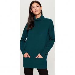 Długi sweter z golfem - Turkusowy. Czerwone golfy damskie marki Mohito, z bawełny. Za 129,99 zł.