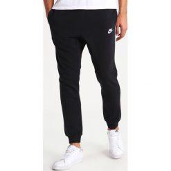 Nike Sportswear Spodnie treningowe black/white. Czarne spodnie dresowe męskie Nike Sportswear, z bawełny. Za 379,00 zł.