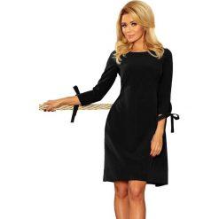 Czarna Sukienka z Kokardkami i Paskiem. Białe sukienki balowe marki numoco, do pracy, l, z nadrukiem, z elastanu, z kopertowym dekoltem, z długim rękawem, kopertowe. Za 158,90 zł.