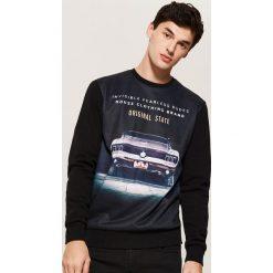 Bluza z nadrukiem - Czarny. Czarne bluzy męskie rozpinane marki KIPSTA, z poliesteru, do piłki nożnej. Za 69,99 zł.