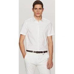 Koszula z krótkim rękawem - Biały. Brązowe koszule chłopięce marki QUECHUA, m, z elastanu, z krótkim rękawem. W wyprzedaży za 49,99 zł.