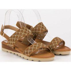 LAURITA ażurowe płaskie sandały brązowe. Brązowe sandały damskie Primavera, w ażurowe wzory, na płaskiej podeszwie. Za 49,99 zł.