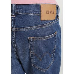 Edwin ED90 SKINNY Jeansy Slim Fit mid trip used. Niebieskie rurki męskie Edwin. Za 419,00 zł.