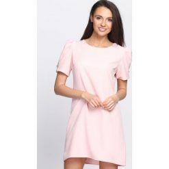 Różowa Sukienka Thunderbird. Różowe sukienki letnie marki numoco, l, z dekoltem w łódkę, oversize. Za 79,99 zł.