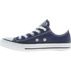 Converse - Tenisówki dziecięce Chuck Taylor All Star. Białe buty sportowe chłopięce marki Converse, z aplikacjami, z materiału, przed kostkę. W wyprzedaży za 139,90 zł.