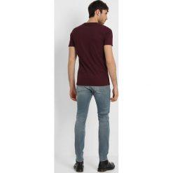 Denham BOLT Jeans Skinny Fit sza. Niebieskie rurki męskie marki Criminal Damage. Za 839,00 zł.