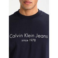 Calvin Klein Jeans HAMATO REGULAR FIT Bluza night sky. Niebieskie kardigany męskie Calvin Klein Jeans, m, z bawełny. Za 399,00 zł.