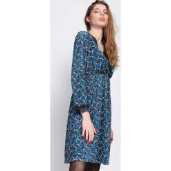 Niebieska Sukienka Unmistakable. Niebieskie sukienki dzianinowe marki Reserved, l, midi. Za 79,99 zł.