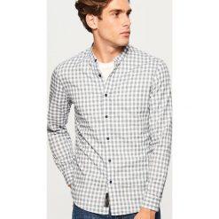 Koszula slim fit z bawełny organicznej - Niebieski. Niebieskie koszule męskie slim marki Reserved, l, z bawełny. Za 99,99 zł.