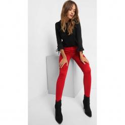 Power Stretch Skinny Jeans. Czarne jeansy damskie skinny marki Orsay, xs, z bawełny, z dekoltem na plecach. Za 79,99 zł.