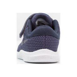 Nike Performance REVOLUTION 4 Obuwie do biegania treningowe neutral indigo/light carbon/obsidian/black/white. Niebieskie buty do biegania damskie Nike Performance, z materiału. Za 129,00 zł.