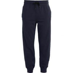 Spodnie dresowe damskie: Ivy Park LOGO JOGGER Spodnie treningowe rainstorm