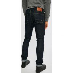 DC - Jeansy Worker. Niebieskie jeansy męskie slim DC. W wyprzedaży za 239,90 zł.