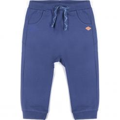 Spodnie. Niebieskie spodnie chłopięce MY DOG, na wiosnę, z nadrukiem, z bawełny, długie. Za 49,90 zł.