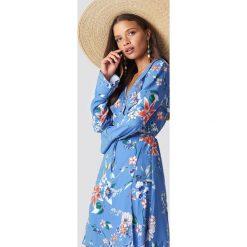 Trendyol Sukienka mini Agapi - Blue. Niebieskie długie sukienki Trendyol, z poliesteru, z kopertowym dekoltem, z długim rękawem, kopertowe. W wyprzedaży za 85,37 zł.